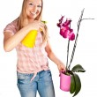 Woman watering orchid flowers — Foto de Stock