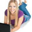 Woman on the floor with laptop — Stock Photo