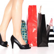 Woman legs in heels and shopping bags — Stock Photo
