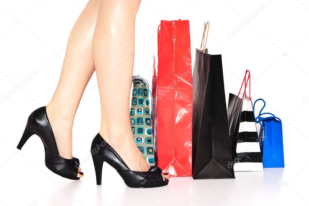 Woman legs in heels and shopping bags — Stock Photo #2810706