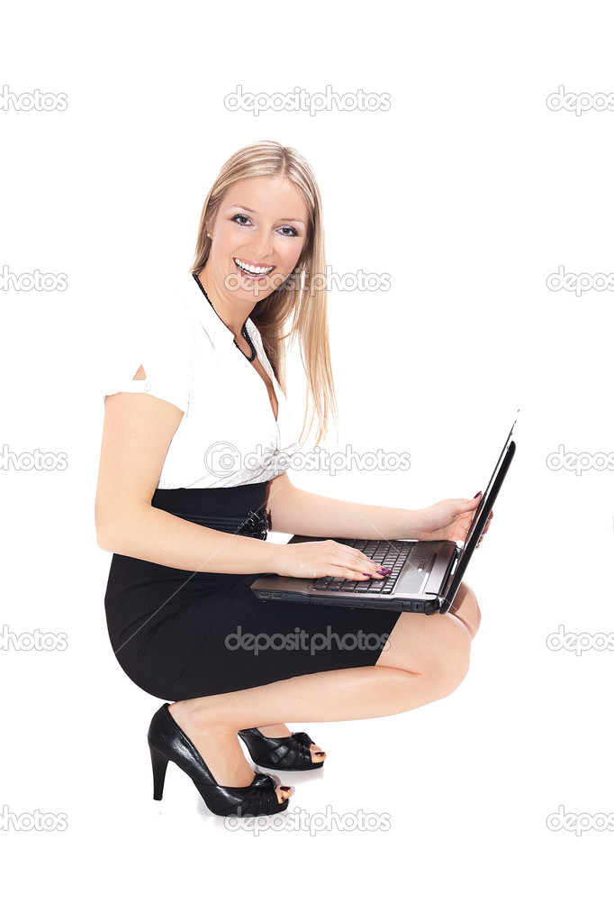Woman crouching on the floor with laptop computer, formal dress  Stock Photo #2810759