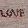 Love sign on sand — Stock Photo