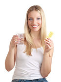 Woman holding birth control pills — Stock Photo