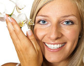 Woman with orchid flowers — Stock Photo