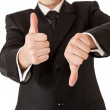 Business man in suit thumbs up and down on white isolated backgr — Stock Photo