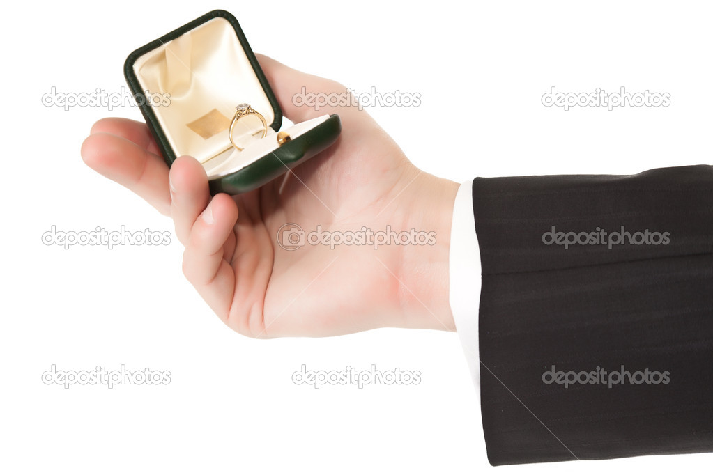 Man in suit holding engagement ring on white isolated background — Stock fotografie #3856263