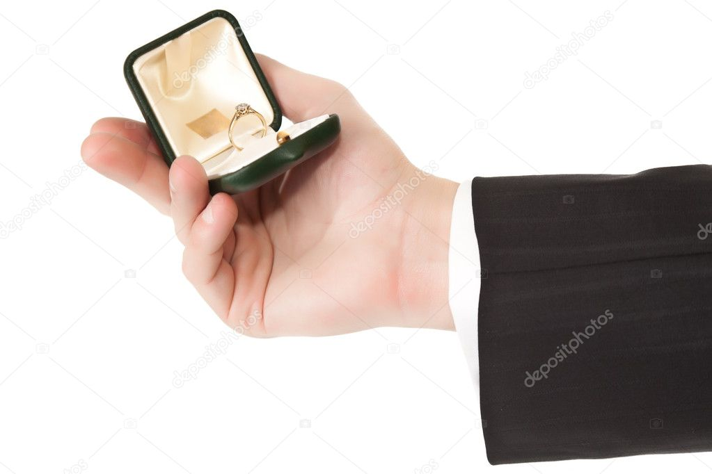 Man in suit holding engagement ring on white isolated background — Stok fotoğraf #3856263