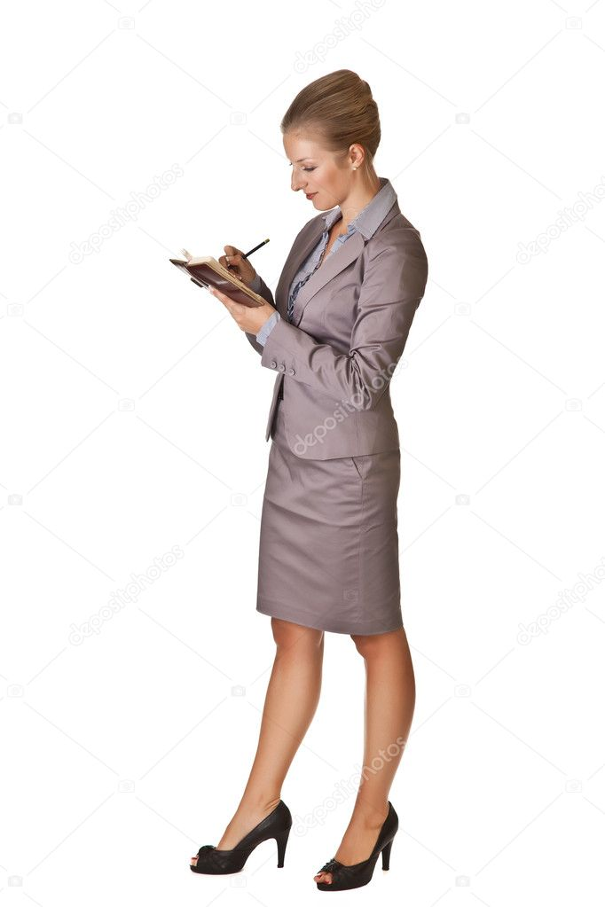 Caucasian blond businesswoman in suit holding calendar scheduler on white isolated background — Stock Photo #3856421