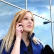 Business lady with cell phone on office against windgenerators a — Stock Photo