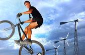Hopping biker trialist — Stock Photo