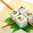 Sushi Rolls structured over white - Stock Photo