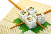 Sushi Rolls structured over white — Stock Photo