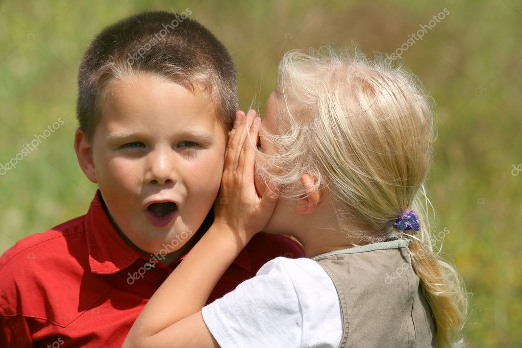 Girl whispering secret to a stunned boy  Stock Photo #2903241