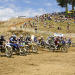 Motocross riders starting — Stock Photo