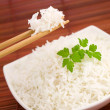 Bowl of rice on mat — Stock Photo #2911568