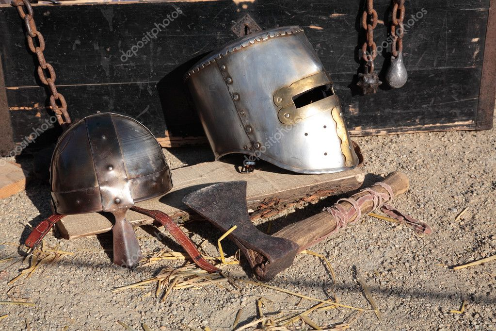 Antic helmets, chains and axe. — Stock Photo #2911392
