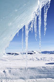 Ice hanging from an edge of an iceberg — Stock Photo