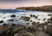 Puesta de sol y mar de fondo — Foto de Stock