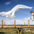 Jumping with a scarf - Stock Photo