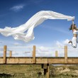 Royalty-Free Stock Photo: Jumping with a scarf