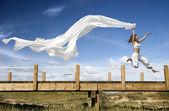 Jumping with a scarf — Stock Photo