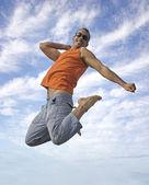 Young active man making a big jump — Stock Photo