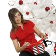 Happy woman with Chirstmas gifts — Stock Photo