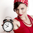 Girl holding a clock — Stock Photo