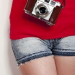 Girl with a vintage camera — Stock Photo