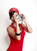 Pin-up girl with a camera — Stock Photo