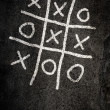 Noughts and Crosses game - Stock Photo