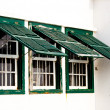Three old green windows from a typical beach house. — Stockfoto