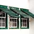 Three old green windows from a typical beach house. - Stock Photo