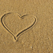 Stock Photo: Love Heart on the Sand