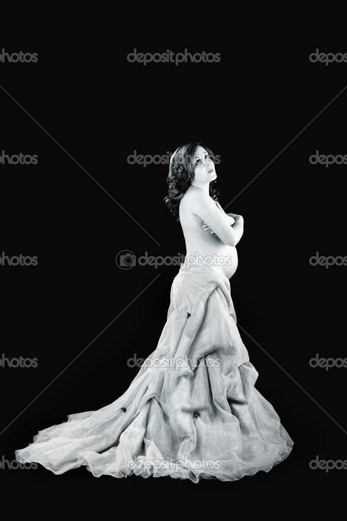 Pregnant woman posing on a black background with beautiful dress — Stock Photo #4936706