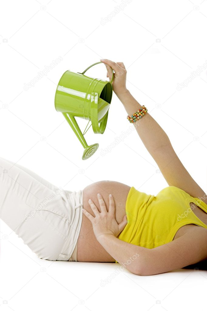 Beautiful pregnant woman watering her tummy to make the Baby growing   — Photo #4936731