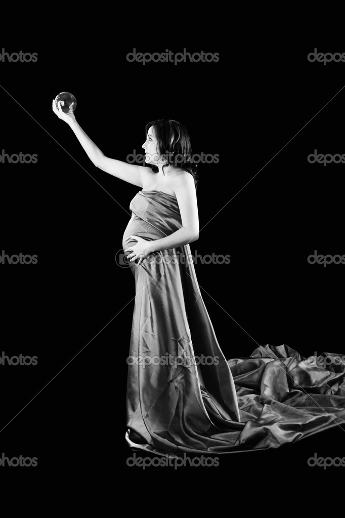 Beautiful Pregnant woman holding a Crystal Ball with a beautiful dress — Stock Photo #4936814