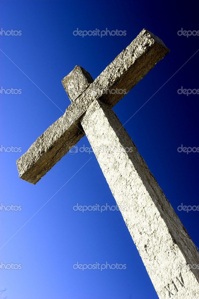 Religious stone cross on a beautiful blue sky — Stock Photo #4938934