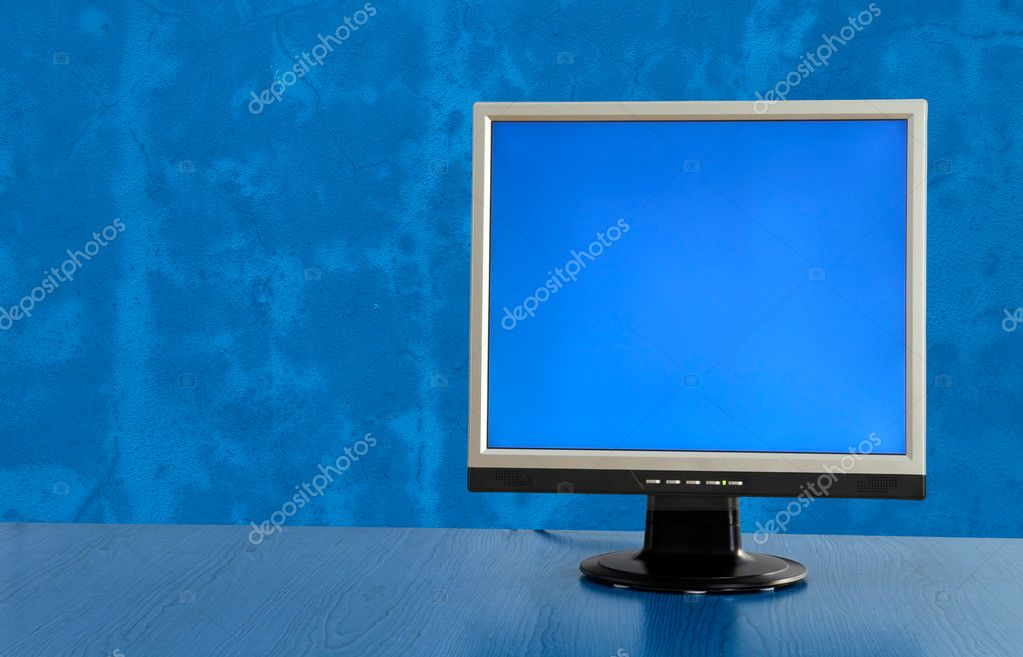 LCD display monitor on a blue room — Stock Photo #4939558