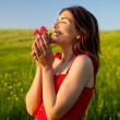 Happy woman with flowers - Stock Photo