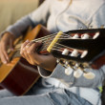 Playing guitar — Stock Photo #5064152