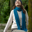 Happy young woman in nature — Stockfoto