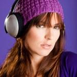 Beautiful woman listening music — Stock Photo #5065794