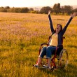 Handicapped woman on wheelchair - Foto Stock