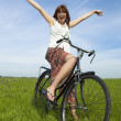 Girl with a bicycle — Stock Photo #5067091