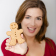 Royalty-Free Stock Photo: Holding a Gingerbread cookie