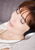 Relax and listening music — Stock Photo