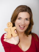 Holding a Gingerbread cookie — Stock Photo