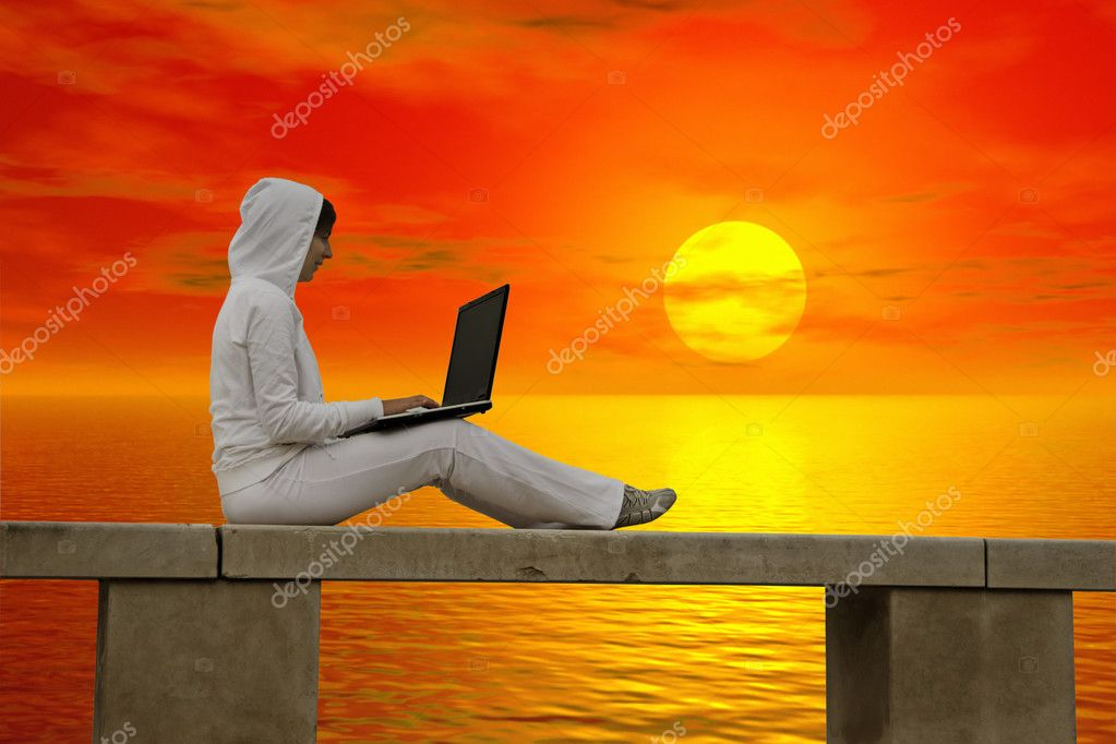 Woman working with is laptop at the sunset — Stock Photo #5063892