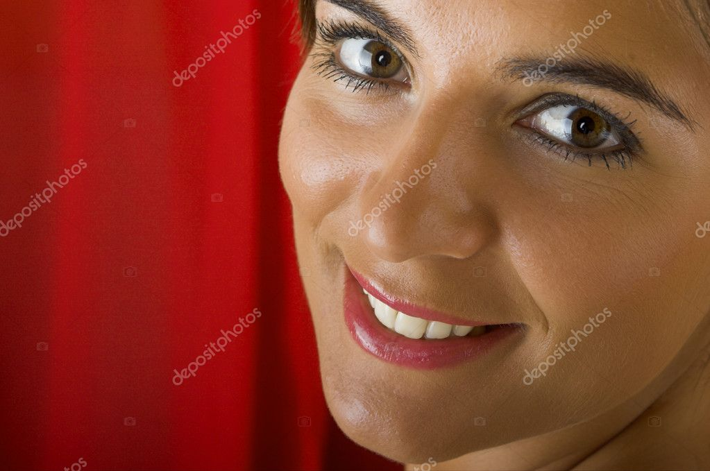 Beautiful young woman portrait on a red background  Stock Photo #5064300